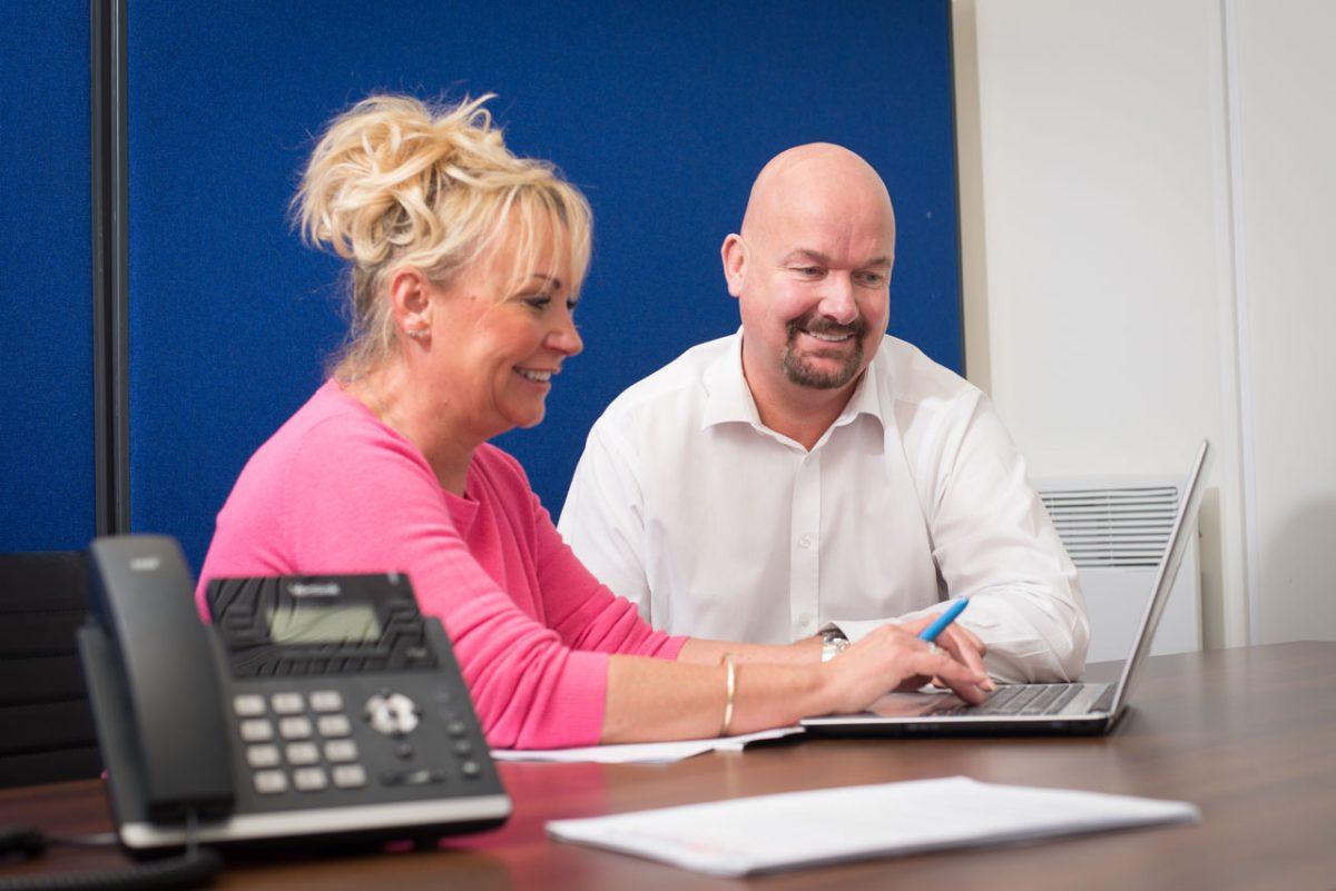 Mark Wiggan working with employee