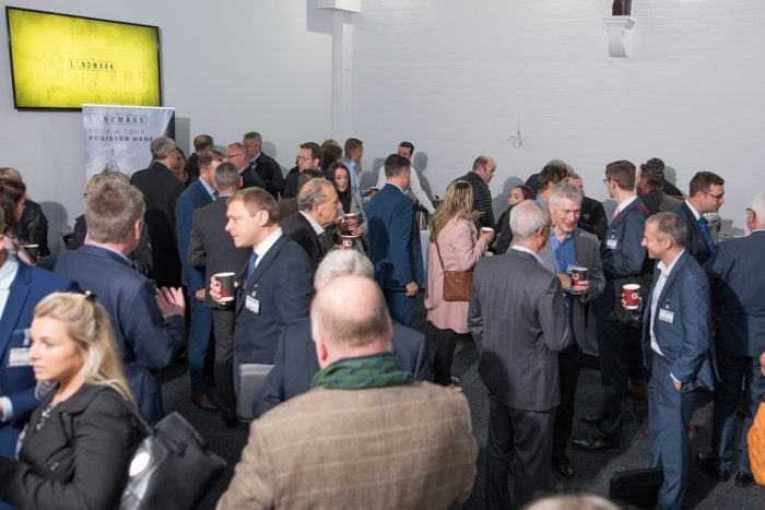 Group of bondholders networking over coffee