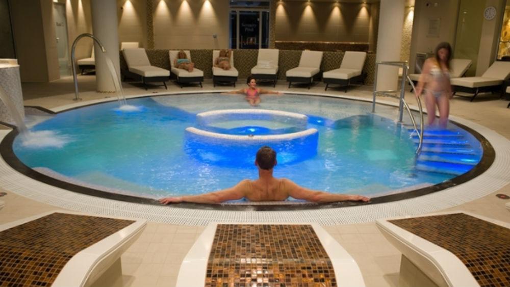 Man relaxing in a circular pool