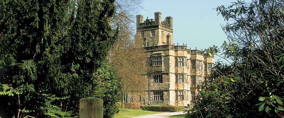 Gawthorpe Hall covered by trees