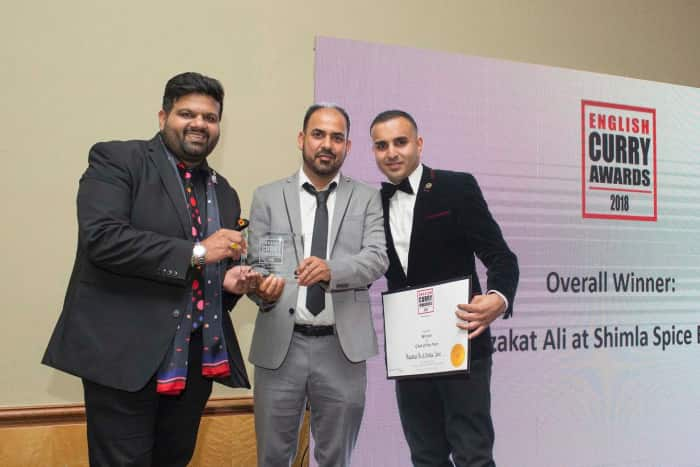 Shimla Spice team holding awards