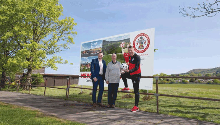 Readstone Construction team stands outside Accrington Stanley Grounds
