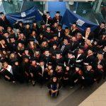 Large group of university graduates smiling in celebration
