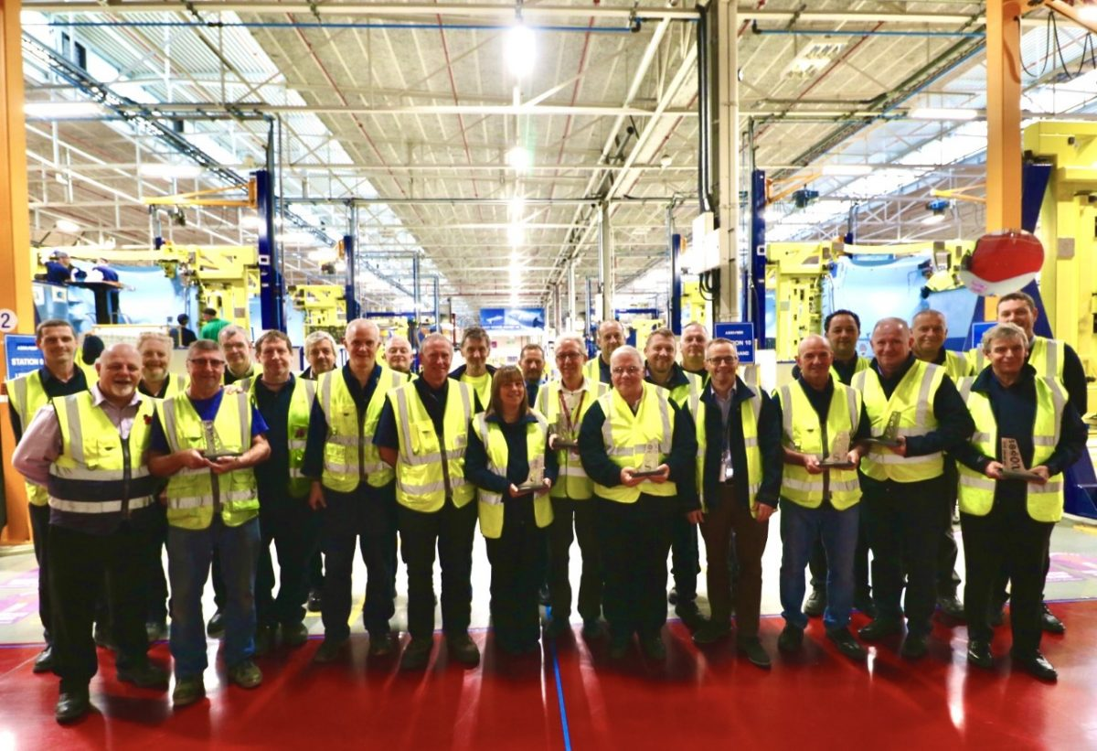 Large group of employees in high vis jackets