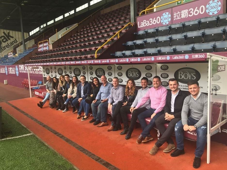 KeyFleet Team sitting on Turf Moor bench