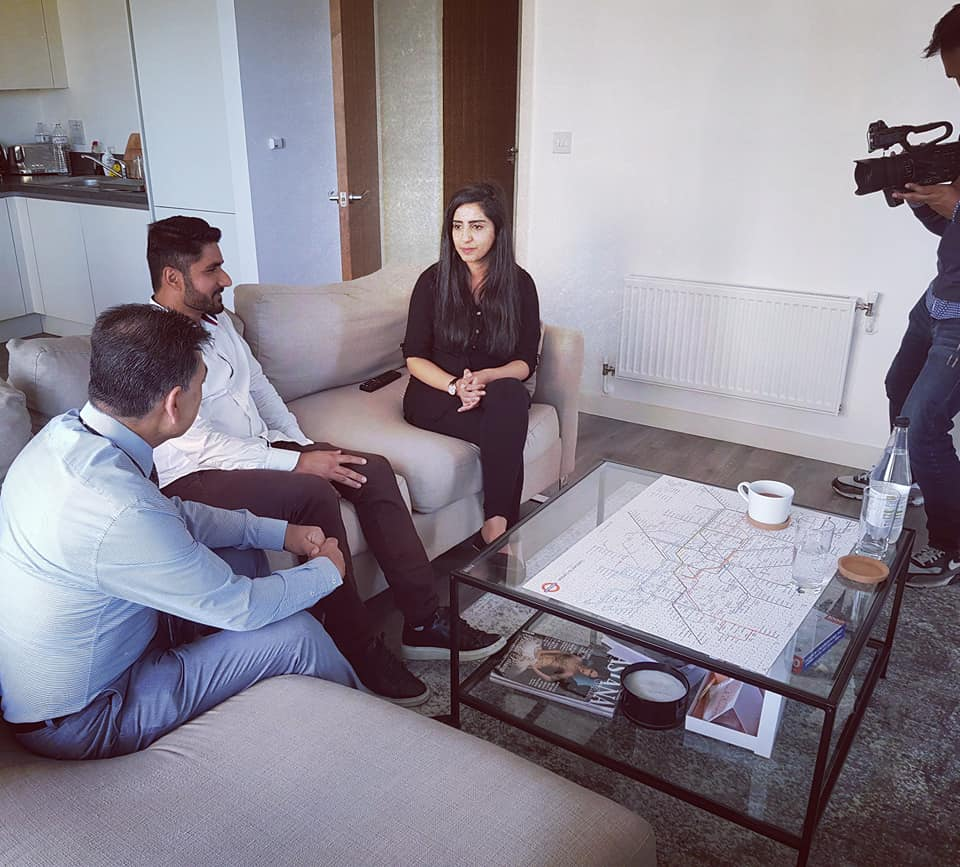 Three British Muslims on a sofa being filmed
