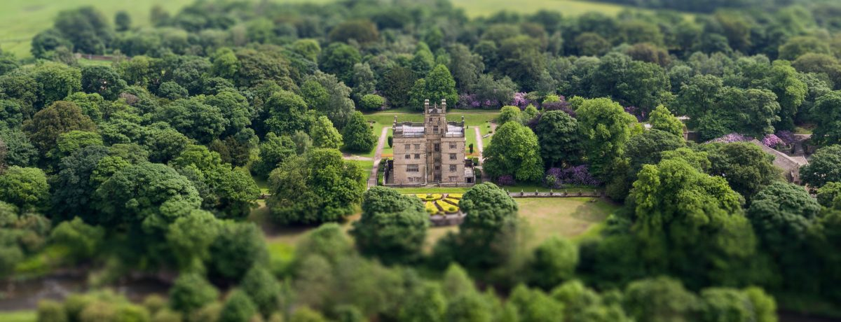 Gawthorpe Hall and grounds, seen from above, surrounded by trees