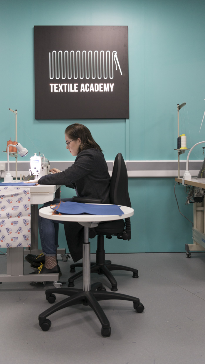 Burnley College Textile Academy - a student sewing