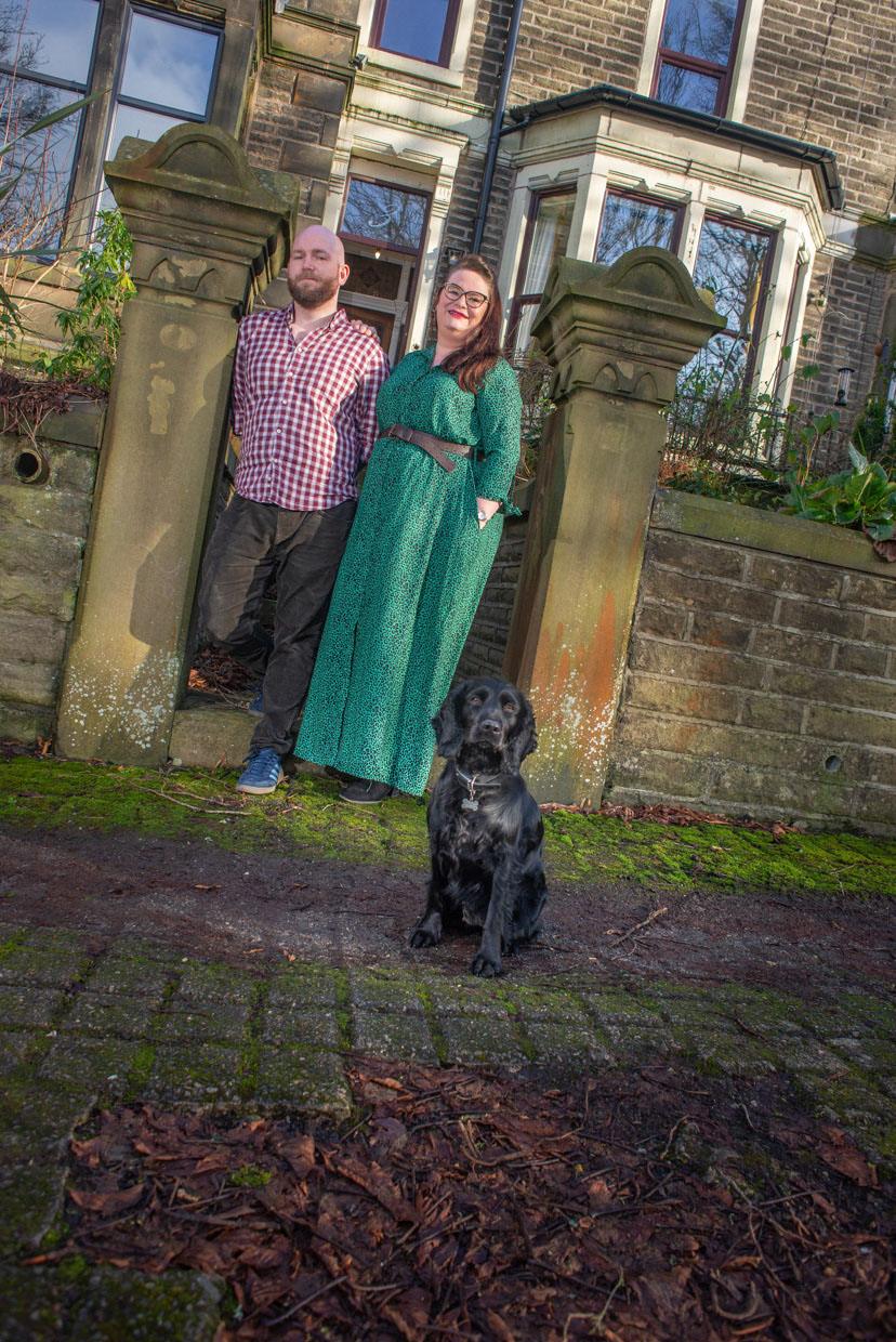 A young couple stood outside their Victorian terrace in Burnley
