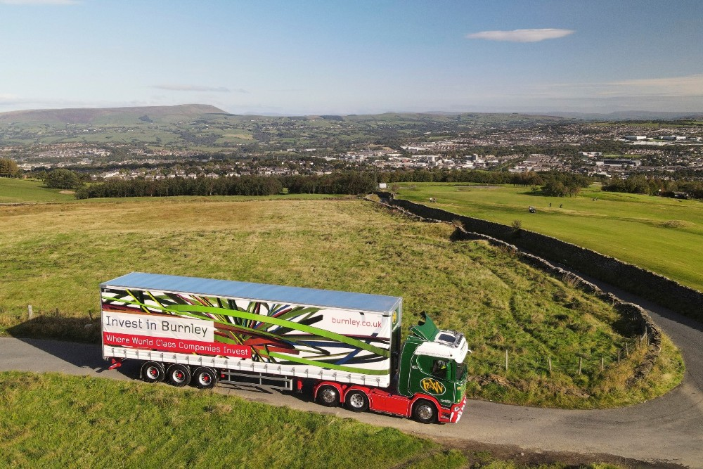 Fagan & Whalley truck driving through Burnley countryside