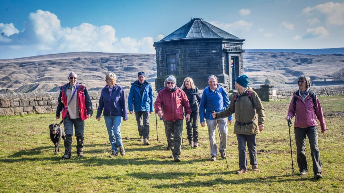 Ramblers walking through the Burnley countryside